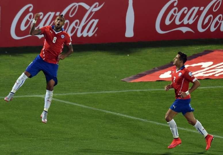 Vidal (L) beat Alexis Sanchez to the award. AFP
