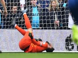 Hugo Lloris gravement blessé au coude avec Tottenham à Brighton. AFP