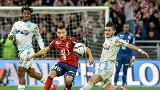 Le milieu de terrain Marvin Martin (c) avec Lille face à Marseille. AFP
