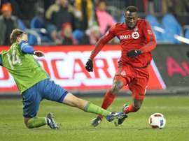 Marshall des Seattle Sounders tente de tacler Jozy Altidore du Toronto FC en finale de la MLS. AFP