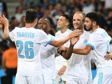 La joie des joueurs de l'OM se congratulent après un but de Valère Germain face à Domzale. AFP