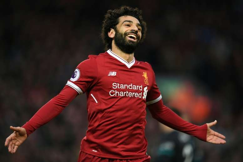 Salah is the Premier League's to scorer with 13 goals from 16 games. AFP