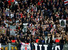 Les supporters du PSG lors du déplacement à Caen. AFP