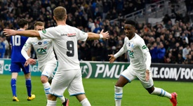 Bouna Sarr (R) is wanted by Atletico Madrid. AFP