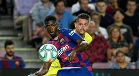 Barcelona can bring in a replacement for Ousmane Dembele (L). AFP