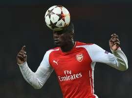 L'attaquant Yaya Sanogo lors d'un match avec Arsenal face au Borussia Dortmund en 2014. AFP