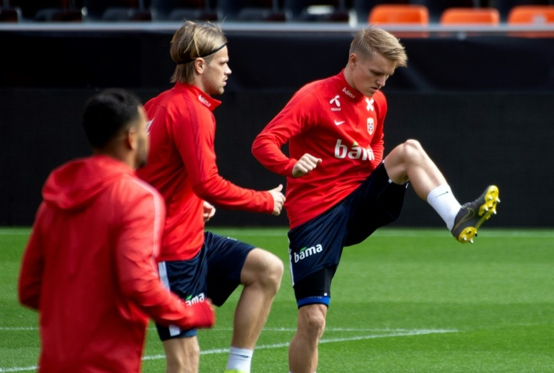 Ajax would be willing to pay up to 20 million for Odegaard. AFP