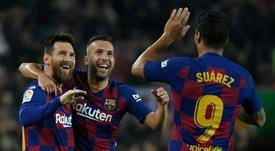 Suárez é muito agradecido a Leo Messi. AFP