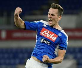 Juventus want to pay less for Milik by offering Bernardeschi. AFP