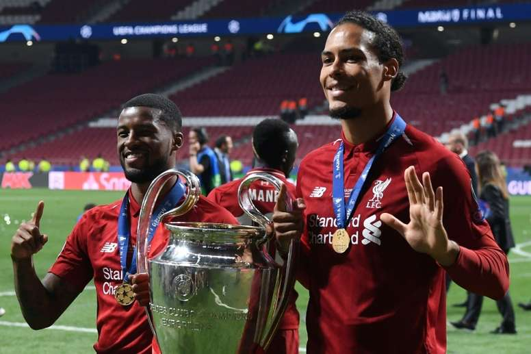 Van Dijk (R) won the Champions League with Liverpool in 2019. AFP