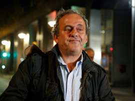 Platini spoke to the press after being released. AFP
