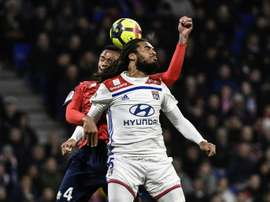 Jason Denayer titulaire avec Lyon contre Lille. AFP