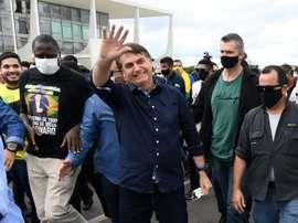 Bolsonaro veut que le foot reprenne, malgré la pandémie. AFP