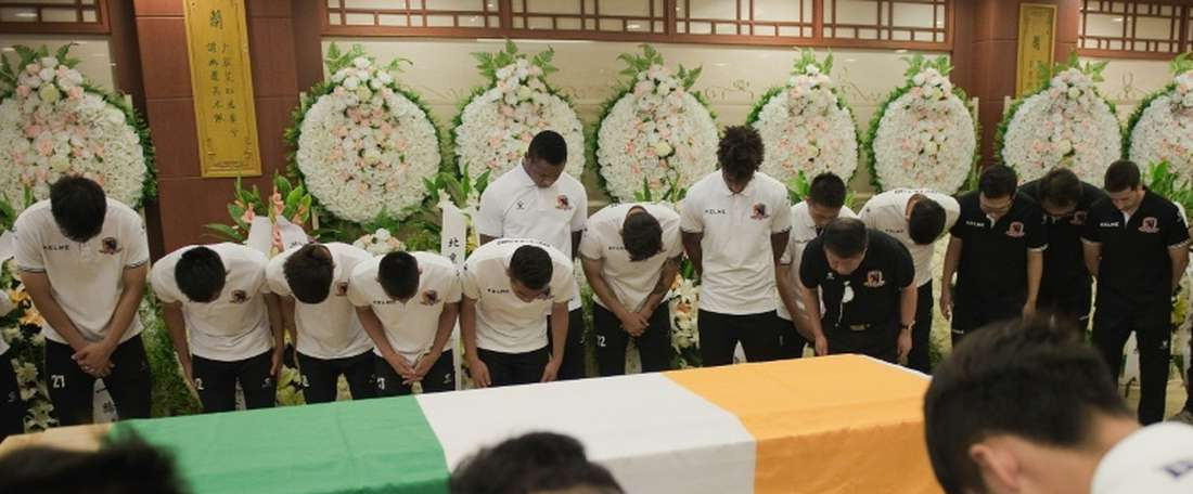 Mourners paid their respects to Cheick Tioté today at a memorial service in China. AFP