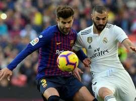 Piqué estaría en perfectas condiciones para jugar ante el Real Madrid. AFP
