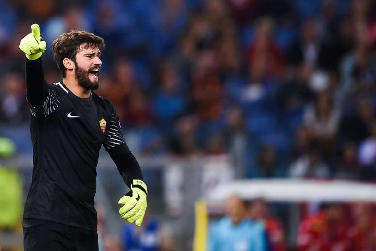 Alisson associado ao Real Madrid. AFP