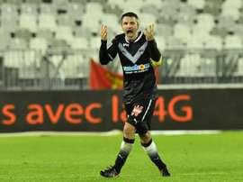 Toulalan não ficou nada satisfeito com os gols sofridos no fim. AFP