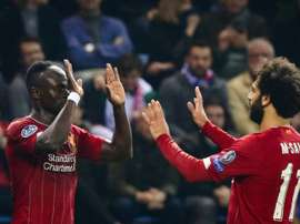 Liverpool souffre un peu puis assure à Genk. AFP
