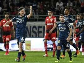 Le milieu de terrain bastiais Yannick Cahuzac fête son but contre Dijon. AFP