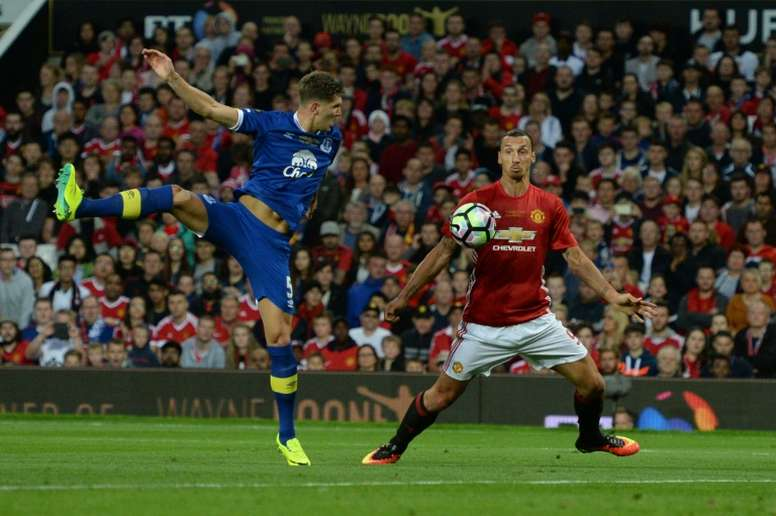 John Stones against Ibrahimovic. AFP