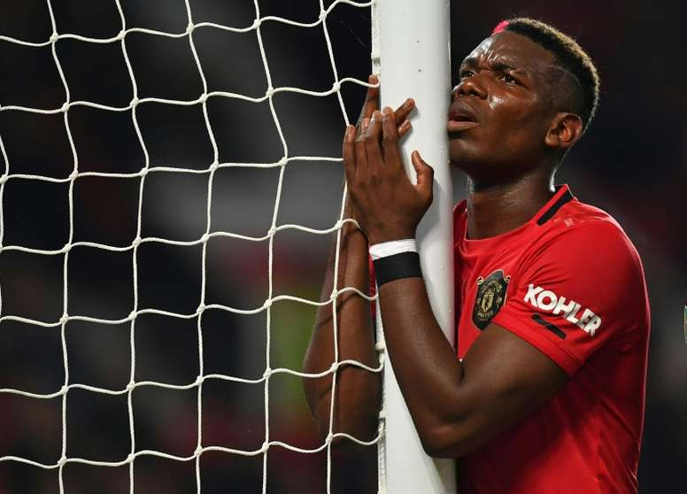 Paul Pogba has missed out on 15 games with United. AFP