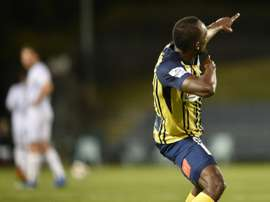 Usain Bolt, devenu footballeur, célèbre son but avec les Central Coast Mariners. AFP