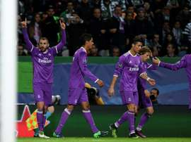 Real Madrid players celebrating a goal against Sporting. AFP