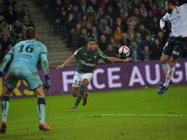 Kevin Monnet Paquet (c) s'apprête à reprendre le ballon contre Dijon. AFP