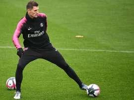 Arsenal enter the bid for Meunier. AFP