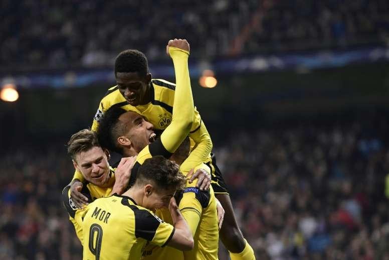 Borussia Dortmund players celebrating a goal. AFP