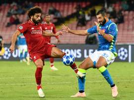 Napoli have announced Albiol (r) will not continue at the club. AFP