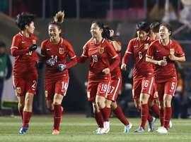 La joie des Chinoises après un but face au Japon en qualification olympique, le 4 mars 2016. AFP