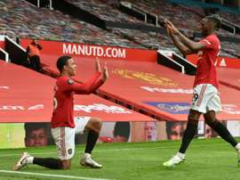 Manchester United vise plus haut. AFP