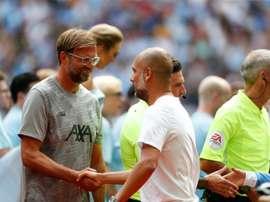 Avantage Jürgen dans le duel entre Klopp et Guardiola. AFP