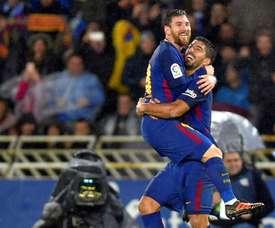 O duo da noite no Anoeta: Messi e Luis Suárez. AFP