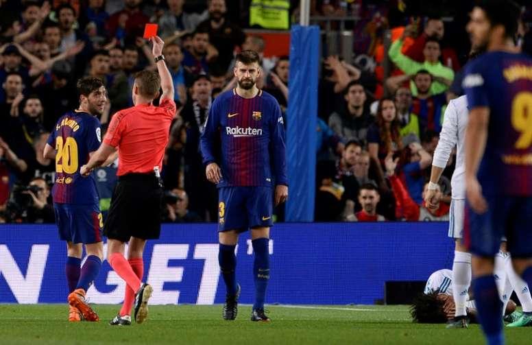 Sergi Roberto fue expulsado ante el Madrid. AFP