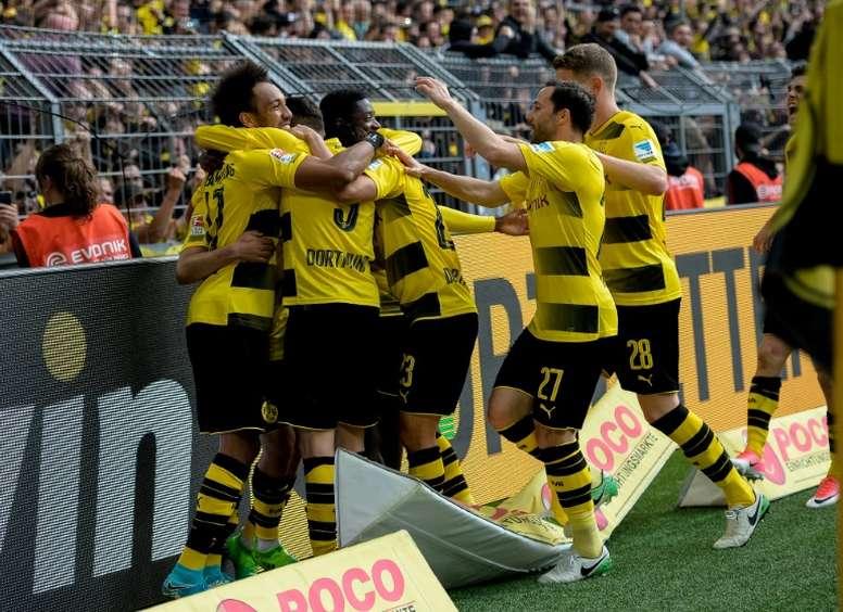 O atacante apontou um hat-trick no triunfo do Borussia. AFP
