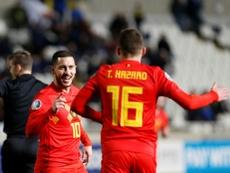 Eden Hazard félicité par son frère Thorgan après son but contre Chypre. AFP