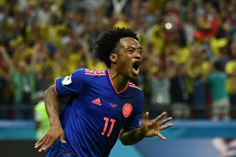 Le Colombien Juan Cuadrado fête un but contre la Pologne lors du Mondial, le 24 juin 2018 à Kazan