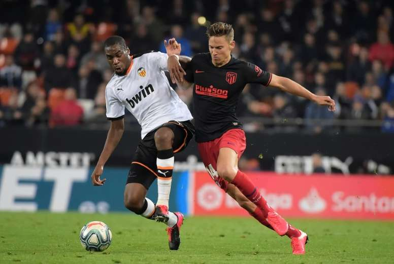 L'Atlético, accroché à Valence, doute encore avant Liverpool. AFP