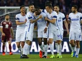 Geoffrey Kondogbia partage sa joie avec ses copéquipiers, après son but contre le Torino. AFP