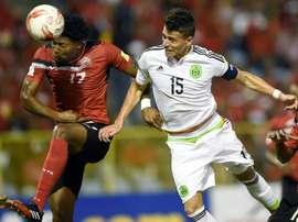 Le joueur du Mexique Hector Moreno et le défenseur de Trinité-et-Tobago, Mekeil Williams. AFP