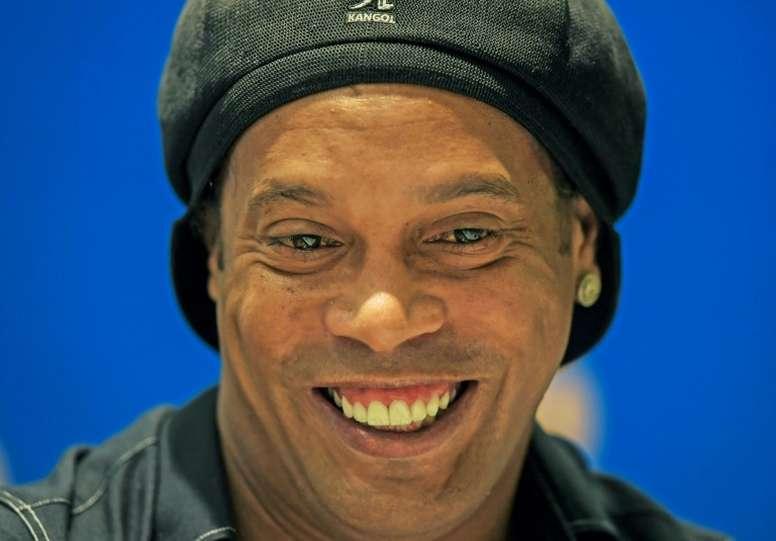 Ronaldinho voltará a Camp Nou em agosto. AFP