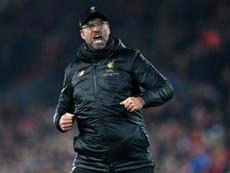 Klopp célèbre la victoire de Liverpool contre Crystal Palace, en Premier League à Anfield. AFP