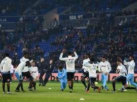 Les joueurs de Marseille à léchauffement avant le coup denvoi du match contre Lyon au Parc OL, le 24 janvier 2016
