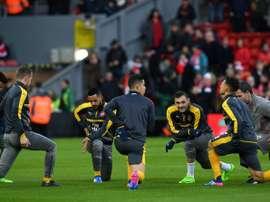 Les joueurs d'Arsenal à l'échauffement à Anfield, à Liverpool, le 4 mars 2017. AFP