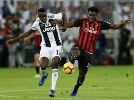 Kessie (r) is attracted Atletico's interest. AFP