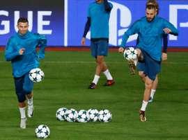 Cristiano Ronaldo, Karim Benzema et leurs coéquipiers du Real à l'entraînement à Nicosie. AFP