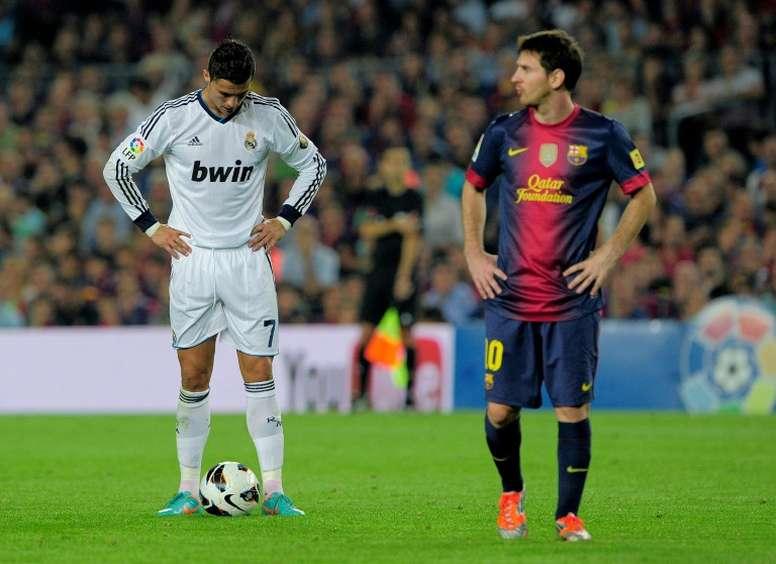 Cristiano se va, pero Messi ganó más. AFP