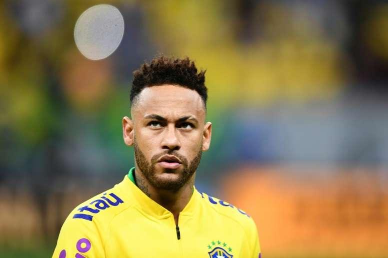 Neymar já teria dito ao grupo seu desejo de voltar. AFP